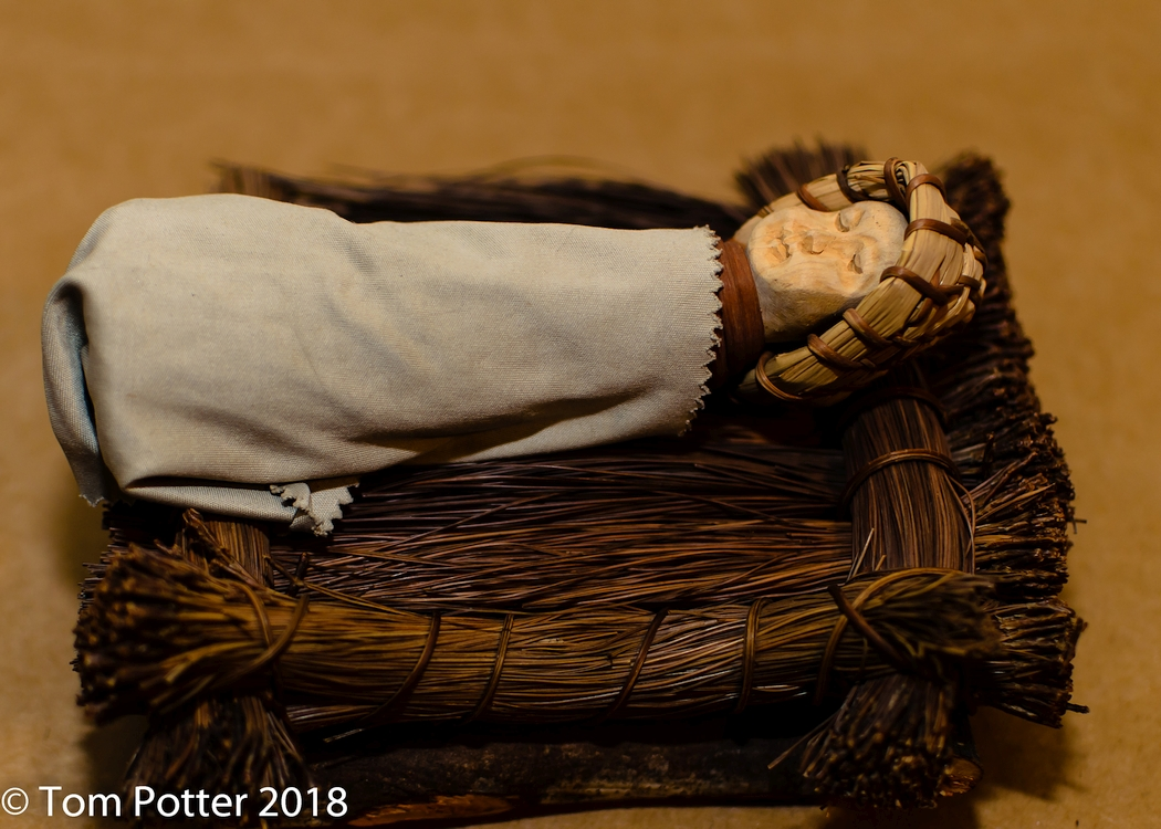 This is what you're to look for: a baby wrapped in a blanket and lying in a manger. Luke 2:12